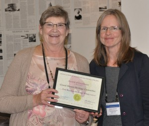 Luise Avery and Roberta Anderson receiving Award of Excellence at Association of Manitoba Museum conference, September 2016